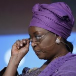 Nigeria's Petroleum Minister and OPEC's alternate president Diezani Alison-Madueke adjusts her glasses at the annual IHS CERAWeek conference in Houston